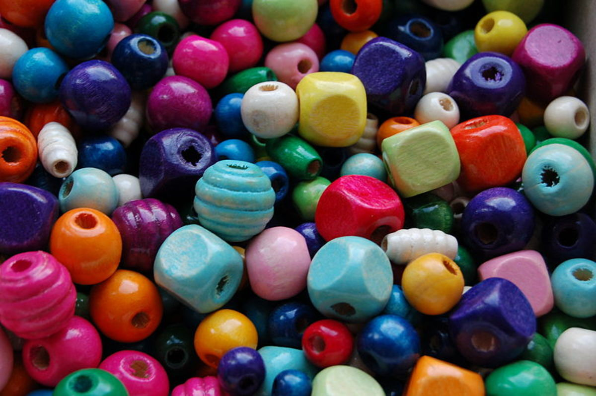 Wooden beads can be bought in a wide range of colours, shapes and sizes. They can also be made using several methods easily and cheaply at home.