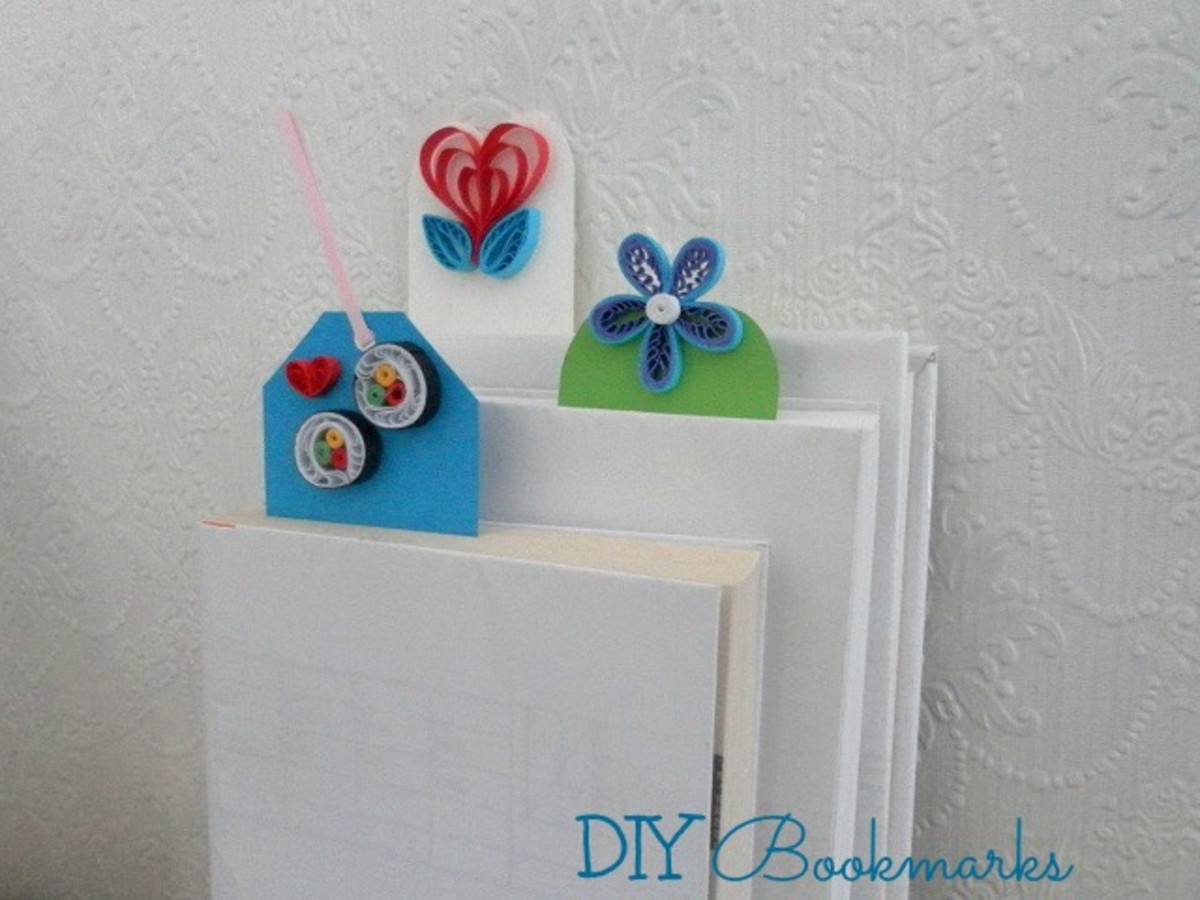 Handmade bookmarks with paper quilled designs.