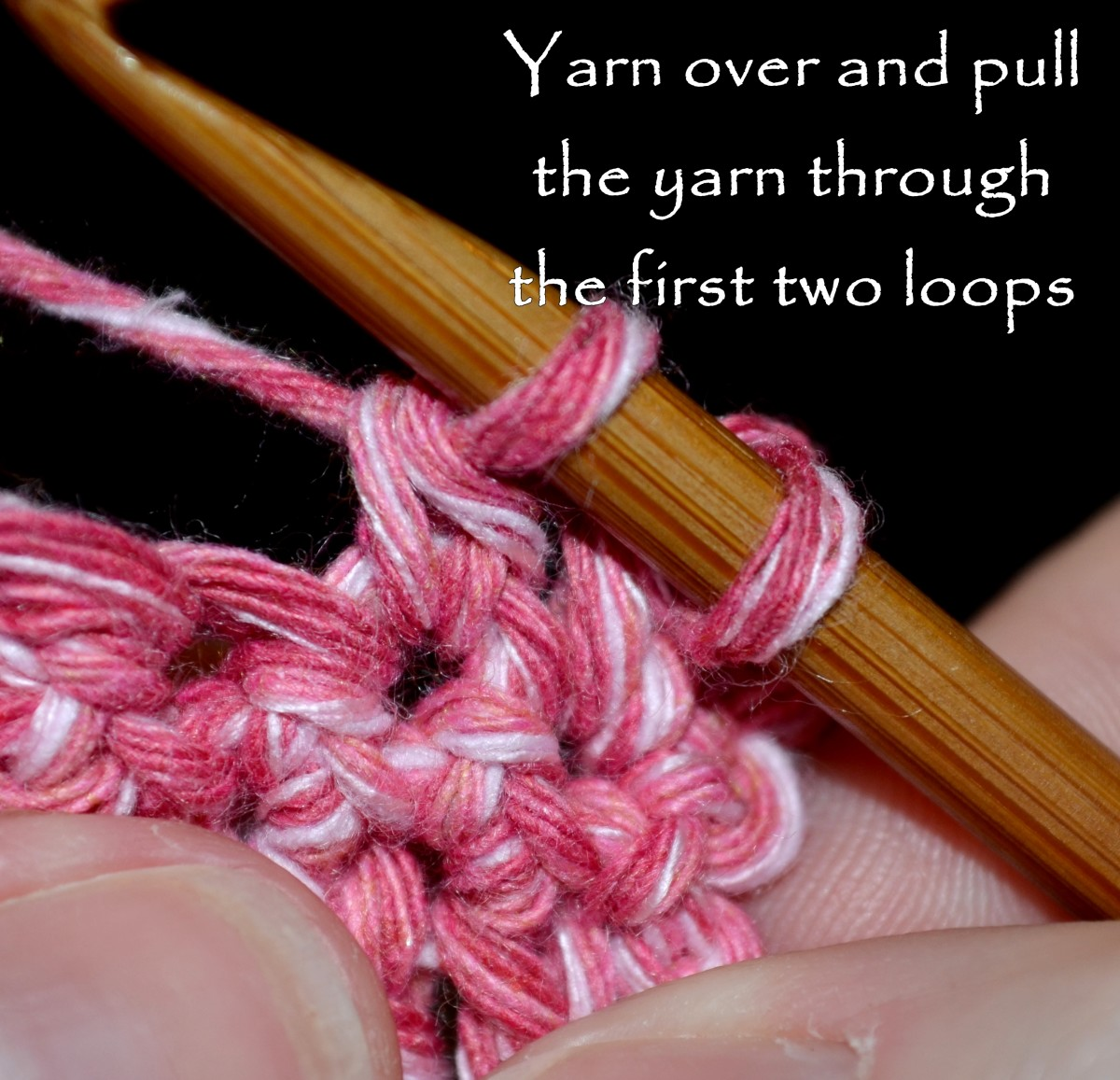 Yarn over and pull the yarn through the first two loops on the hook.