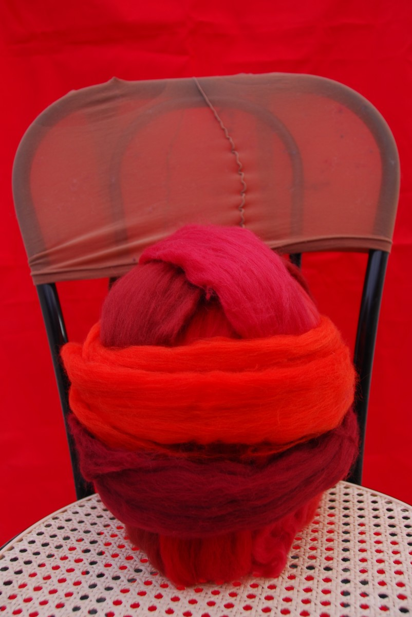 Wool Covered Ball should be sprayed with water and then inserted into the tights.