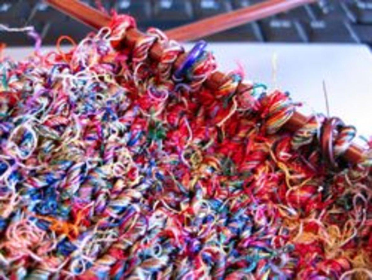 Knitting with silk sari yarn.
