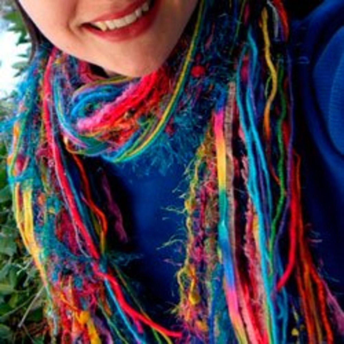 Very simple project - cut lengths of sari yarn with other ribbons and yarns to create a simple yarn scarf with no sewing required.