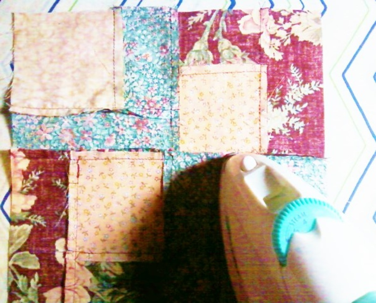 Pressing the final seam after sewing. The block is turned so the right side is facing down.