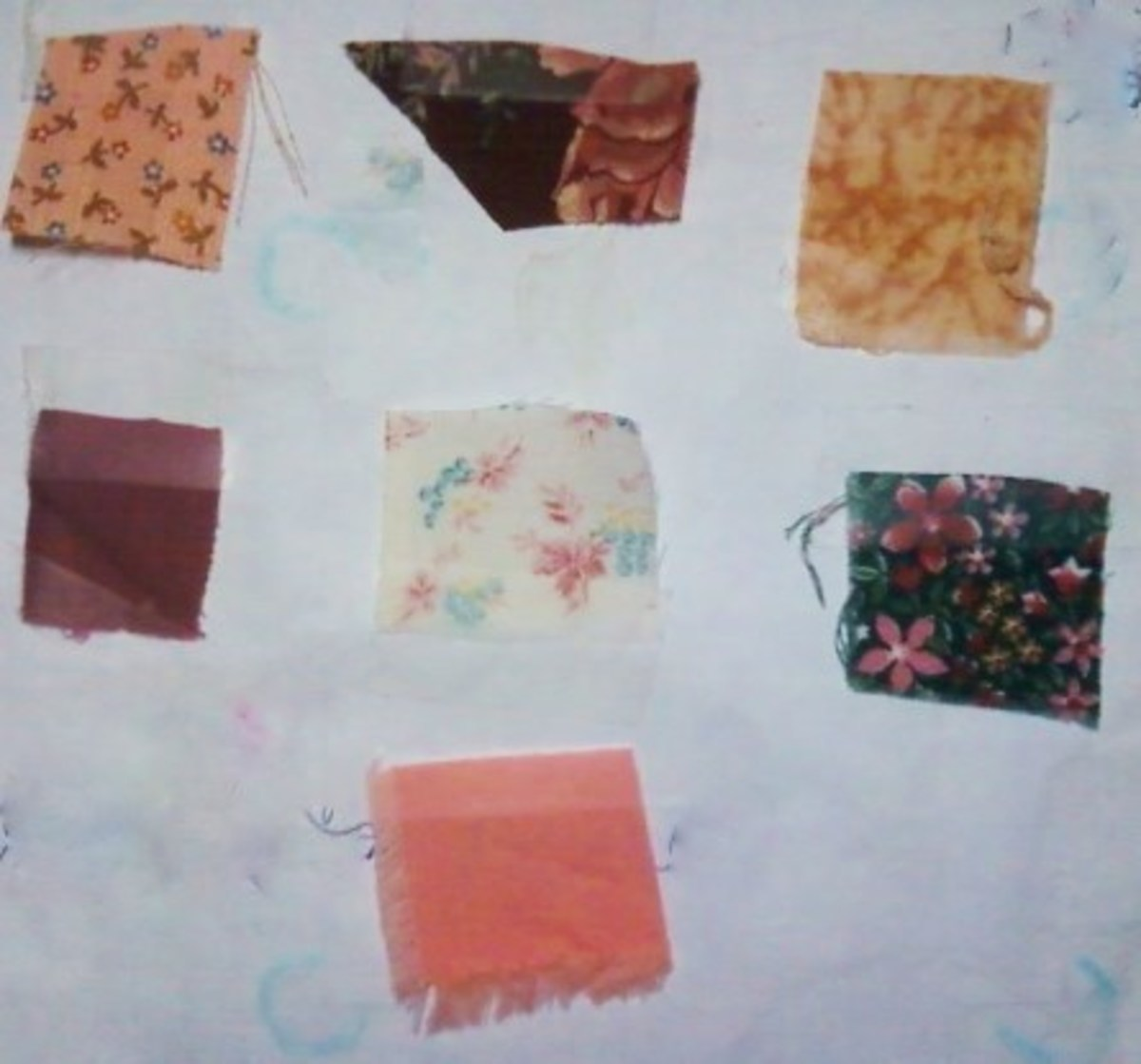 Pink print (top left), large print on cranberry (top center), speckled golden brown (top right), rose (center left), light print (center), dark small flower print (right center), and salmon.