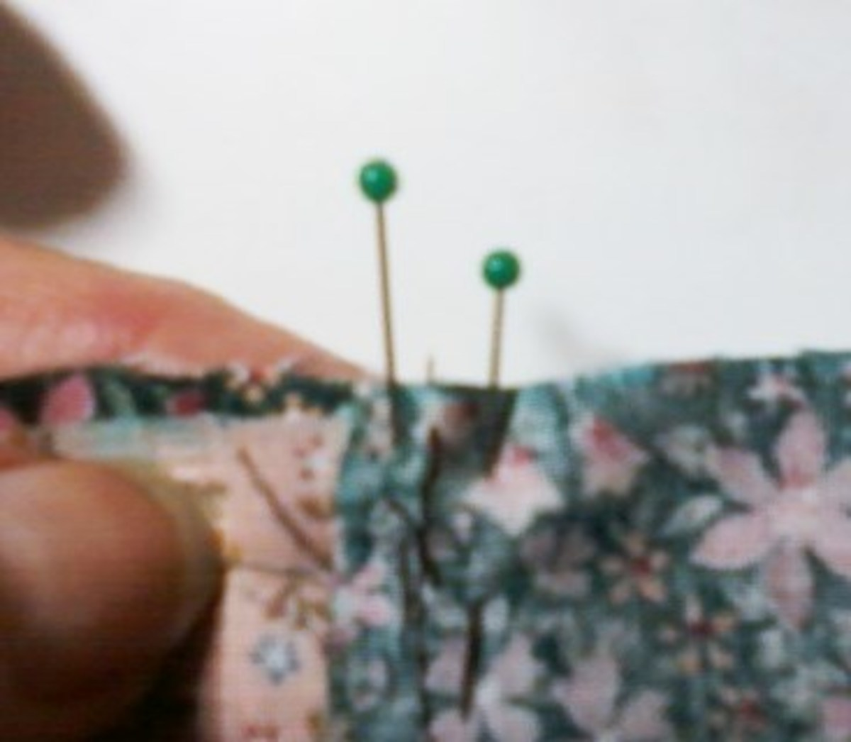 The seams are pinned by placing one straight pin on each side of the seam.