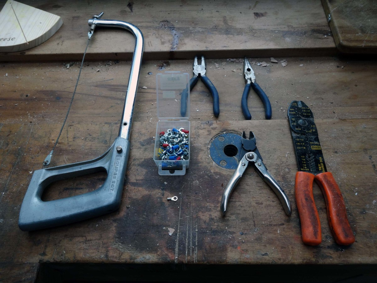 Tools required to upcycle hacksaw blade into a cheese cutter.