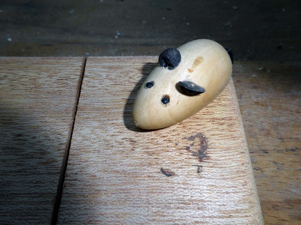 Wooden mouse transferred to the new cheeseboard.