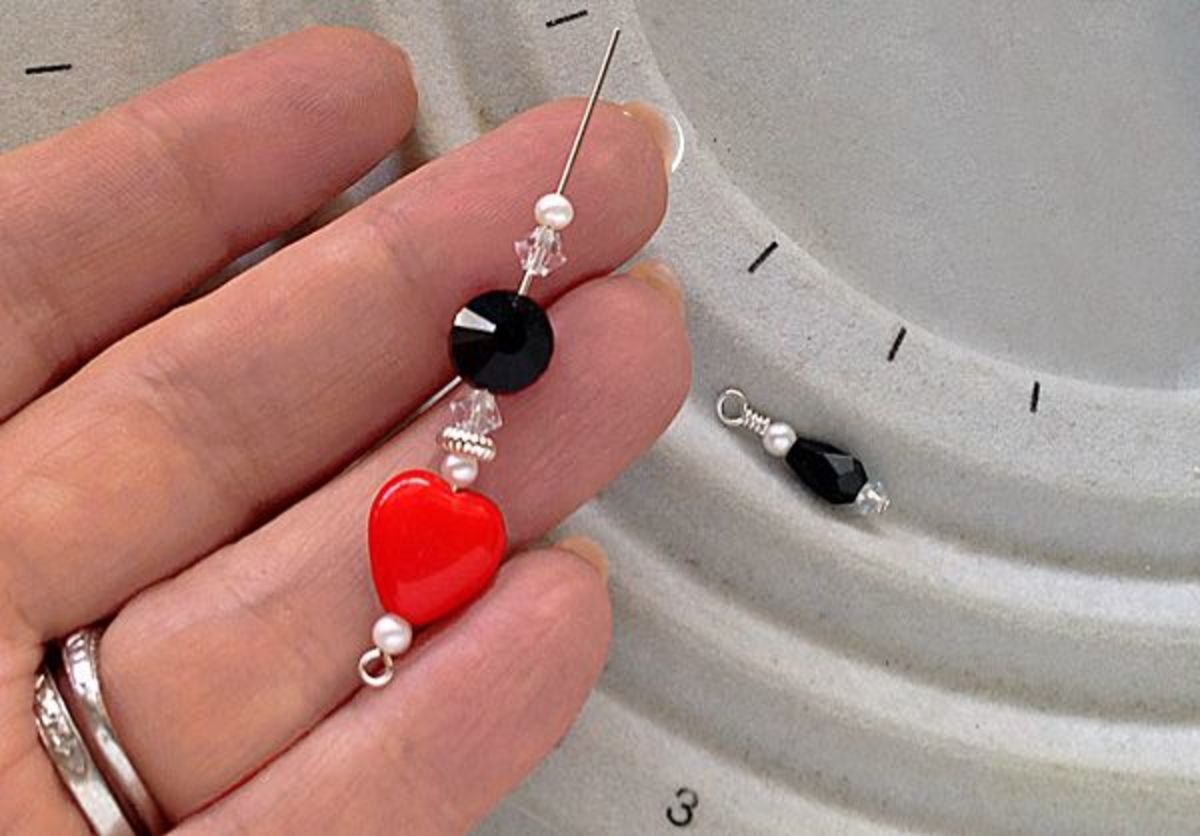 The beads for the top half of the beaded dangle threaded onto the silver eye pin