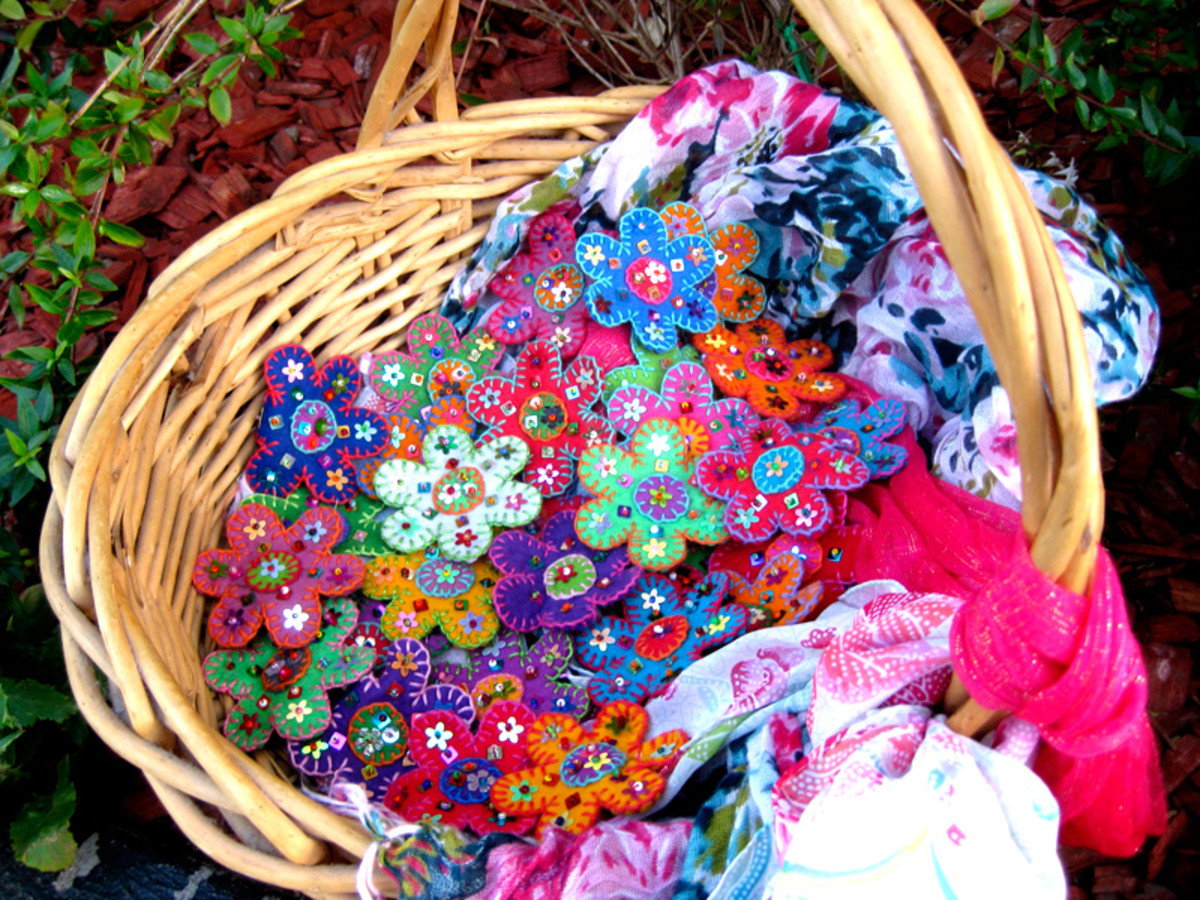 Make lots of different coloured felted flowers and walk around with them outdoors to attract people's attention.
