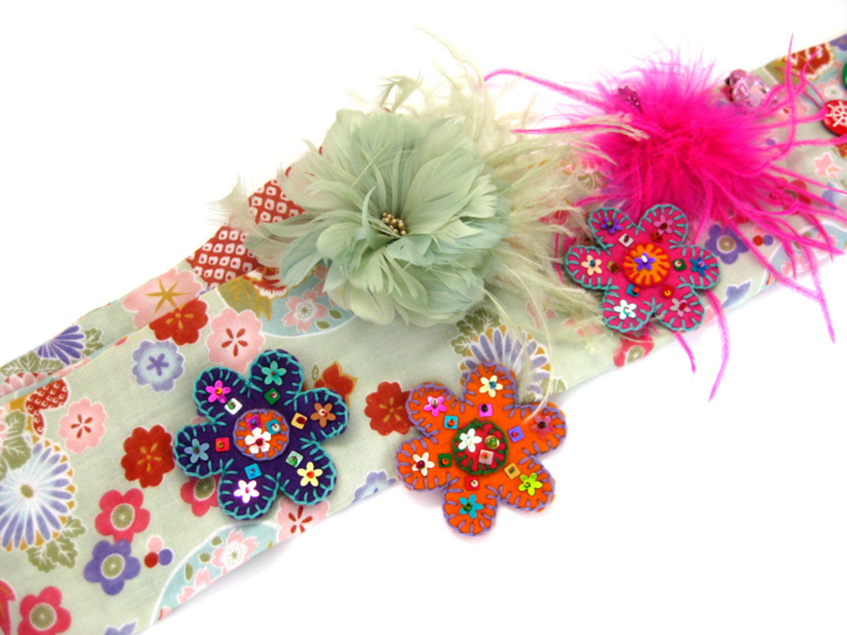 Adding felted flowers to a scarf, along with colourful fascinators. Wear something like this to advertise your wares when selling with a basket.