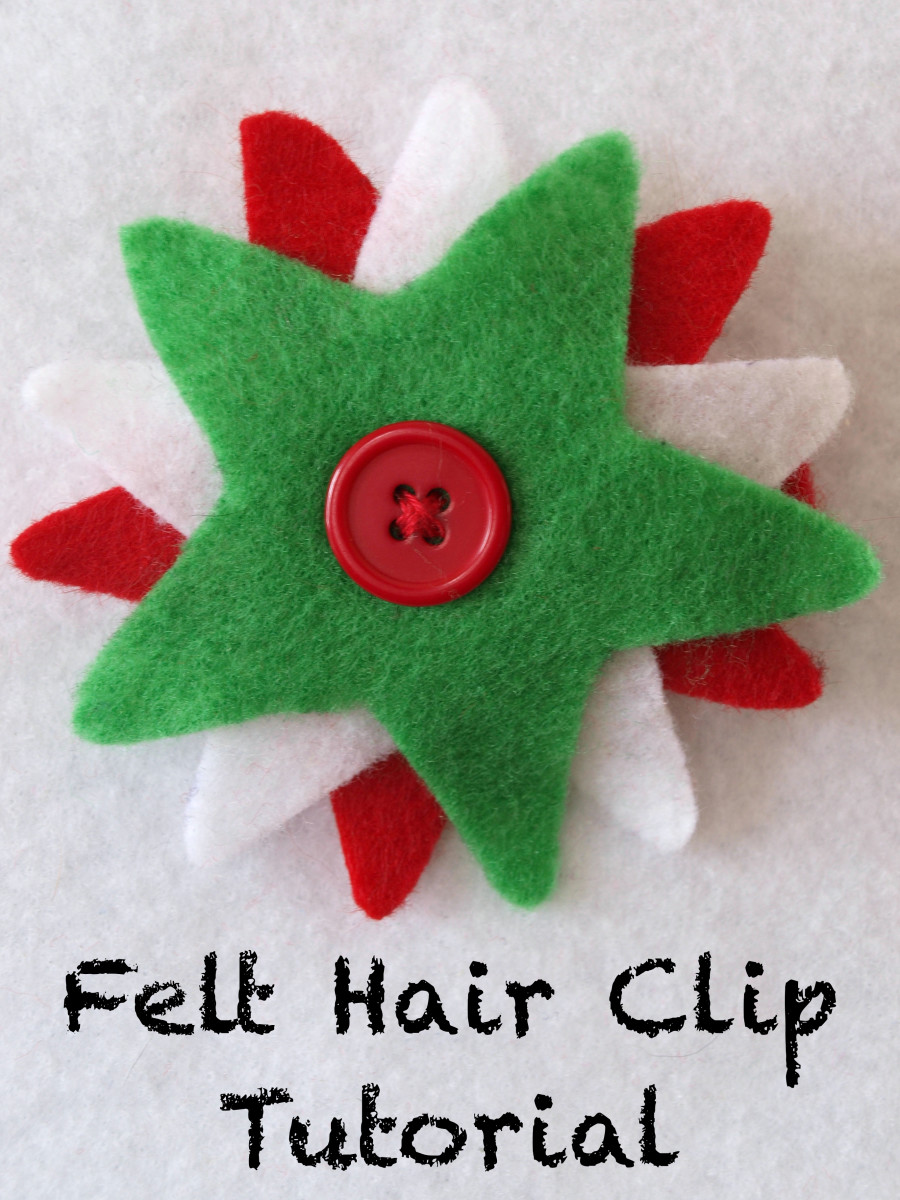 Christmas colors and a star cookie cutter template made this festive hair clip.  The button serves as a decoration as well as the mechanism for attaching the design to the clip.