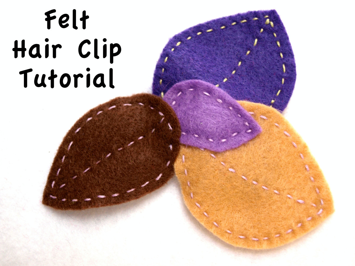 Free form leaf shapes in subtle colors give this barrette an autumn flavor.  No template was used when cutting the shapes and the running stitch anchors the leaves to the clip.