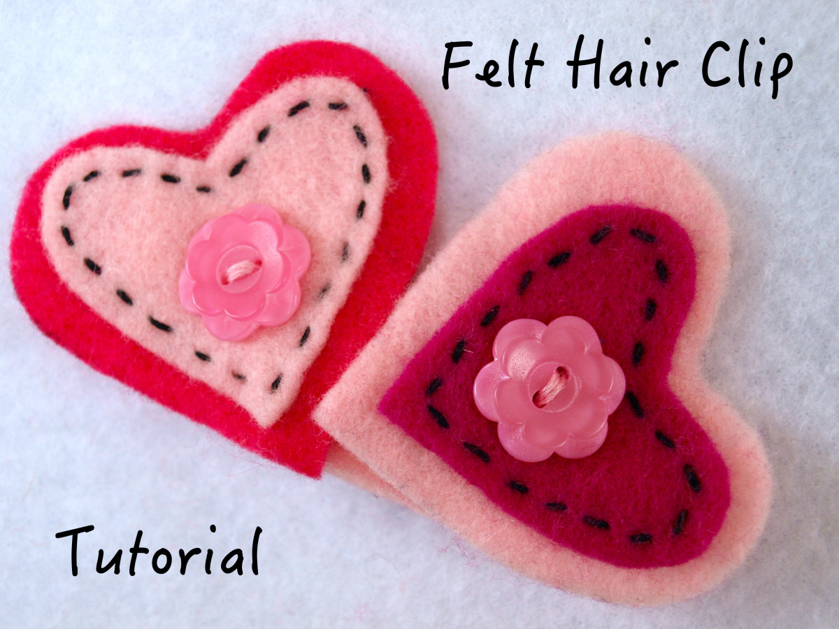 Hearts are a great design for a barrette.  Buttons and the running stitch were used to help anchor the hearts to the clip.