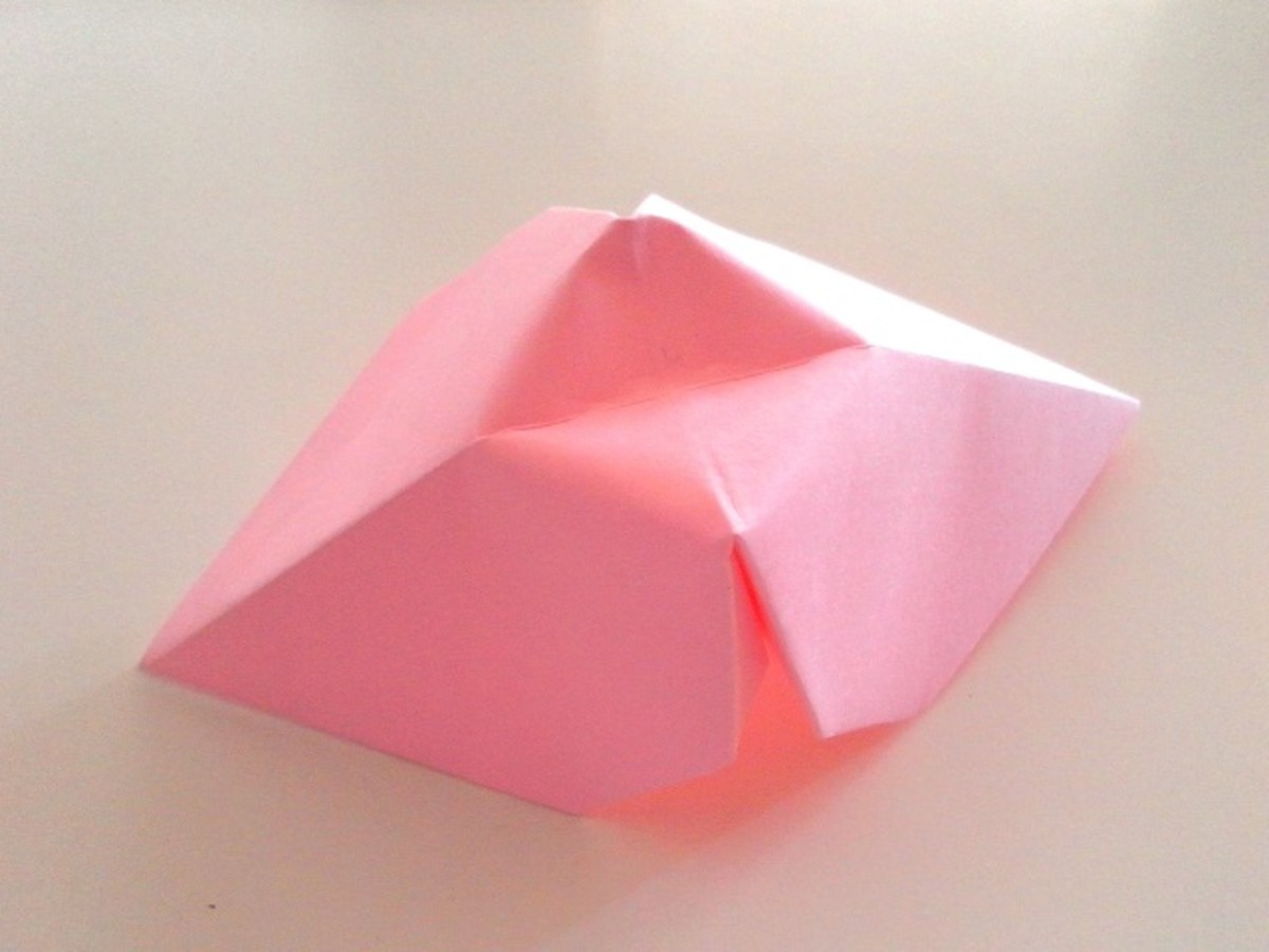 Push the top of the paper downwards to make a small indentation.
