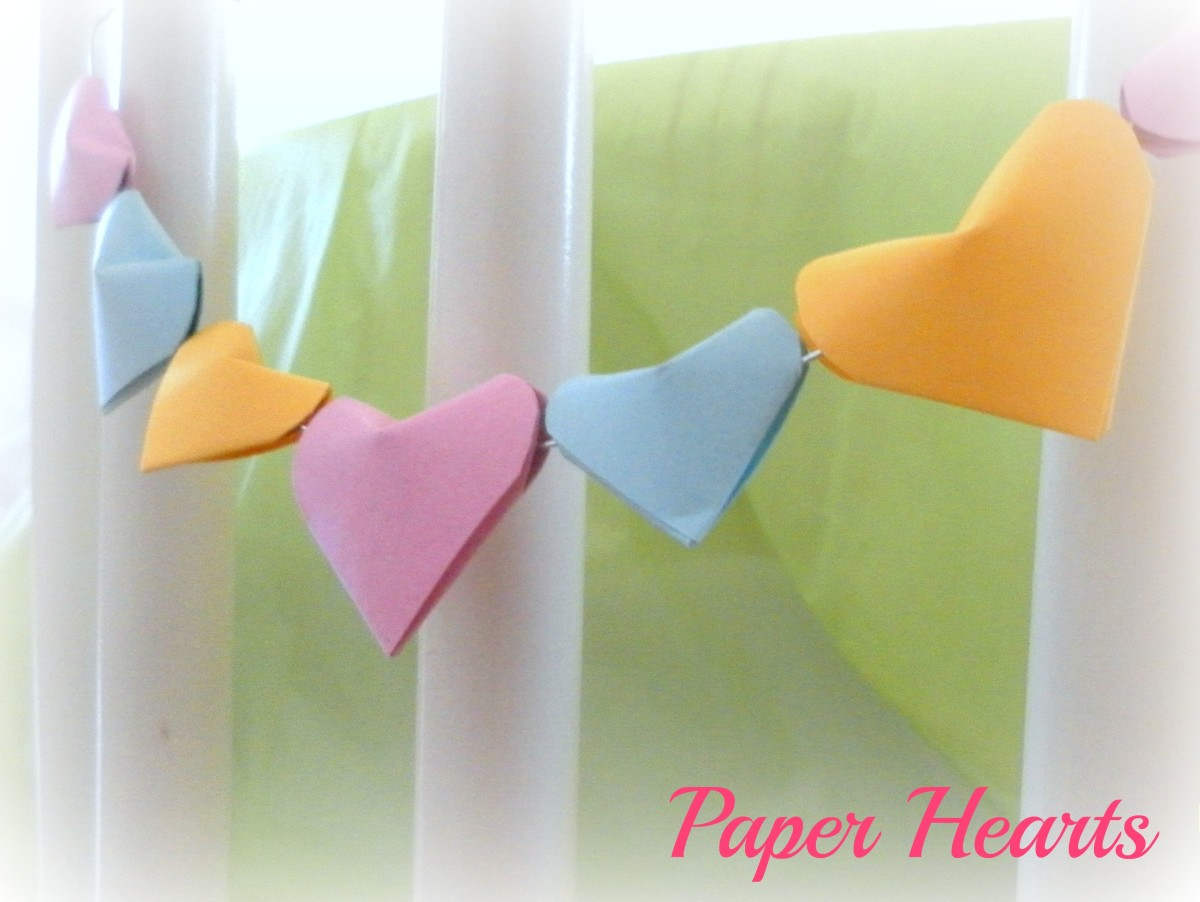 String the paper hearts together to use as décor around the house.