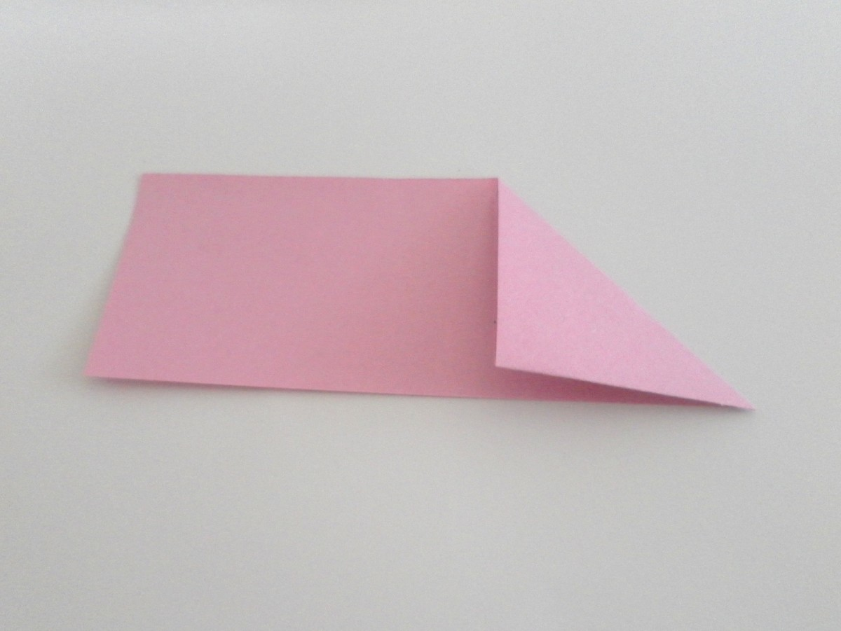 Keep folding the triangles until the other end of the strip of paper is very short.