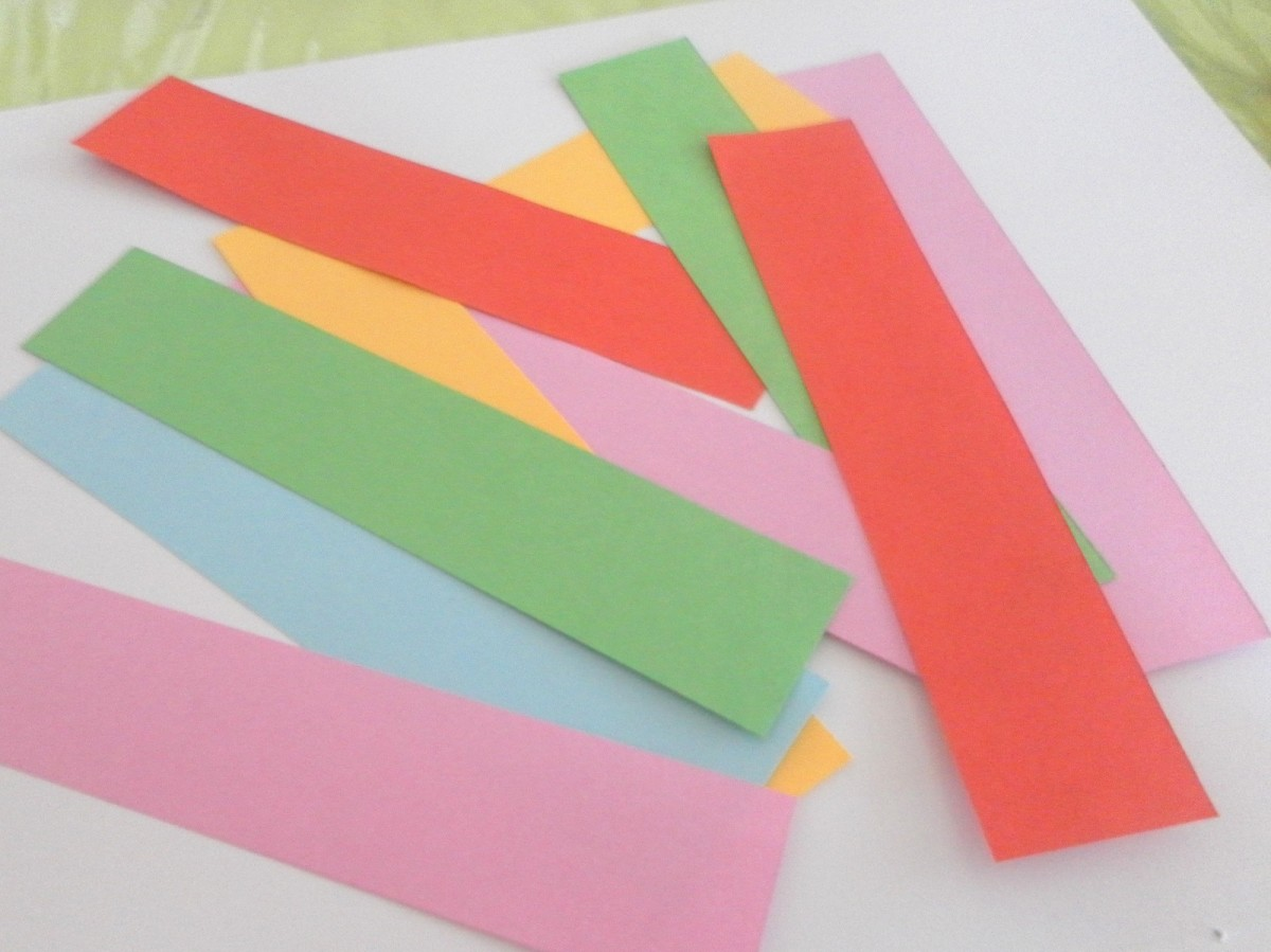 Coloured craft paper cut into strips and ready for making the paper hearts.