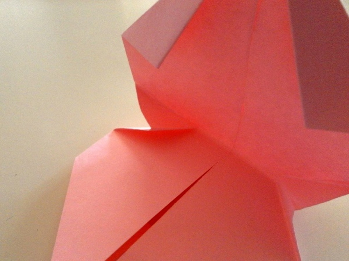 This next step is a little tricky if the origami paper size is very small.