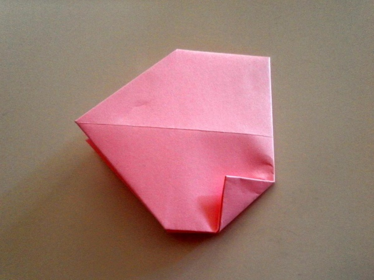 Let's continue making the origami heart. Make a small triangle on the lower right corner.