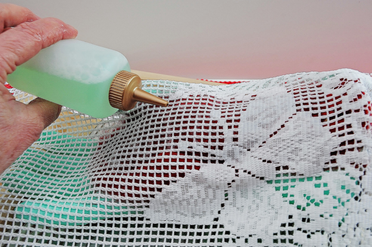 Cover with curtain netting and then wet and smooth down until the fibers are wet through but not saturated with excess water.