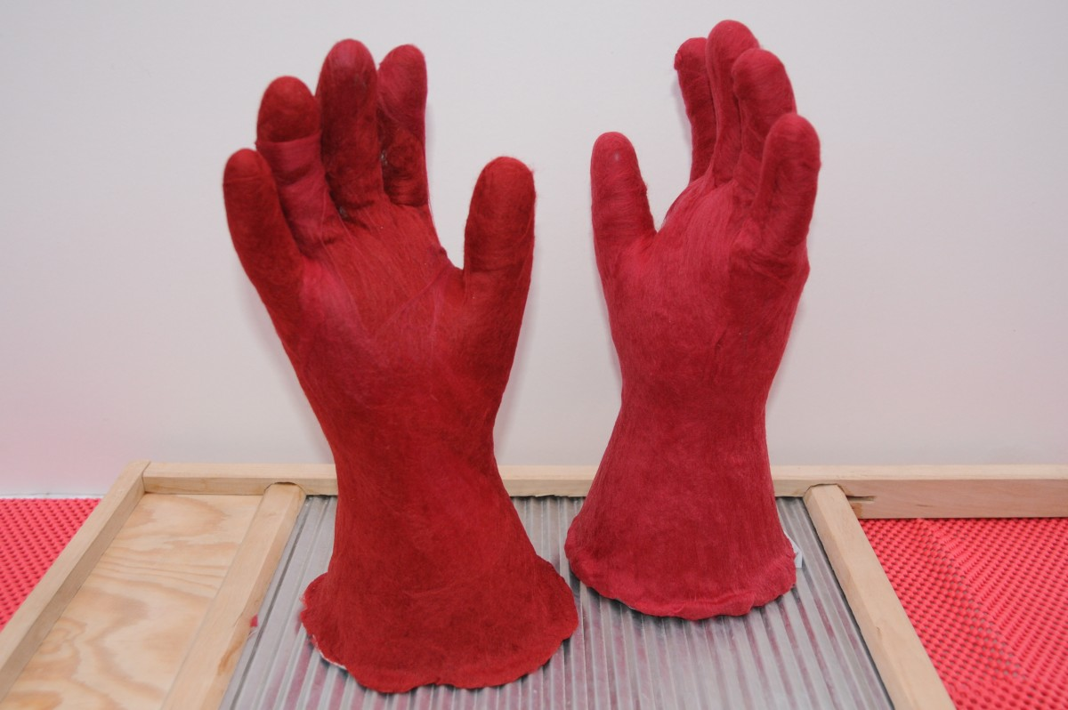 Gloves completely covered in fibers