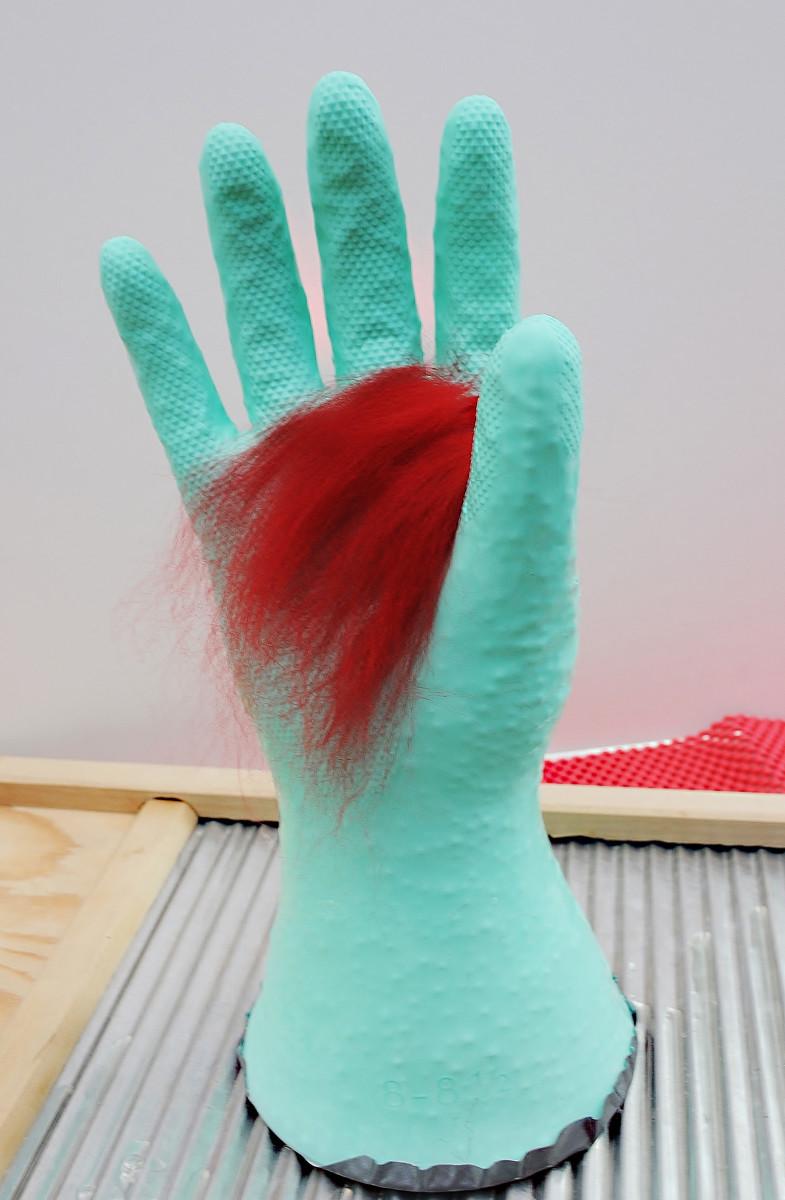 Adding merino wool fibers to the rubber glove