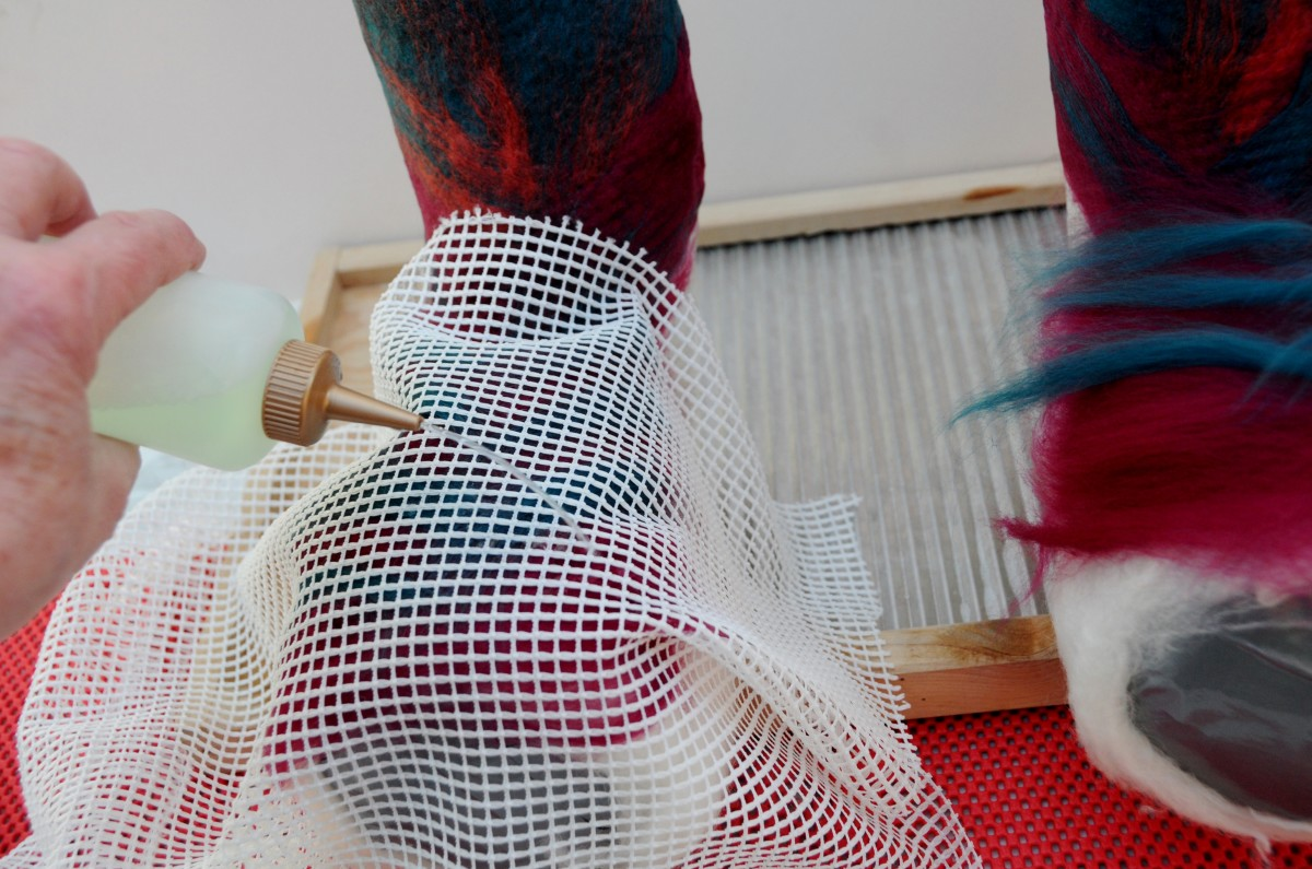 Cover with netting, rub and continue around the foot and leg