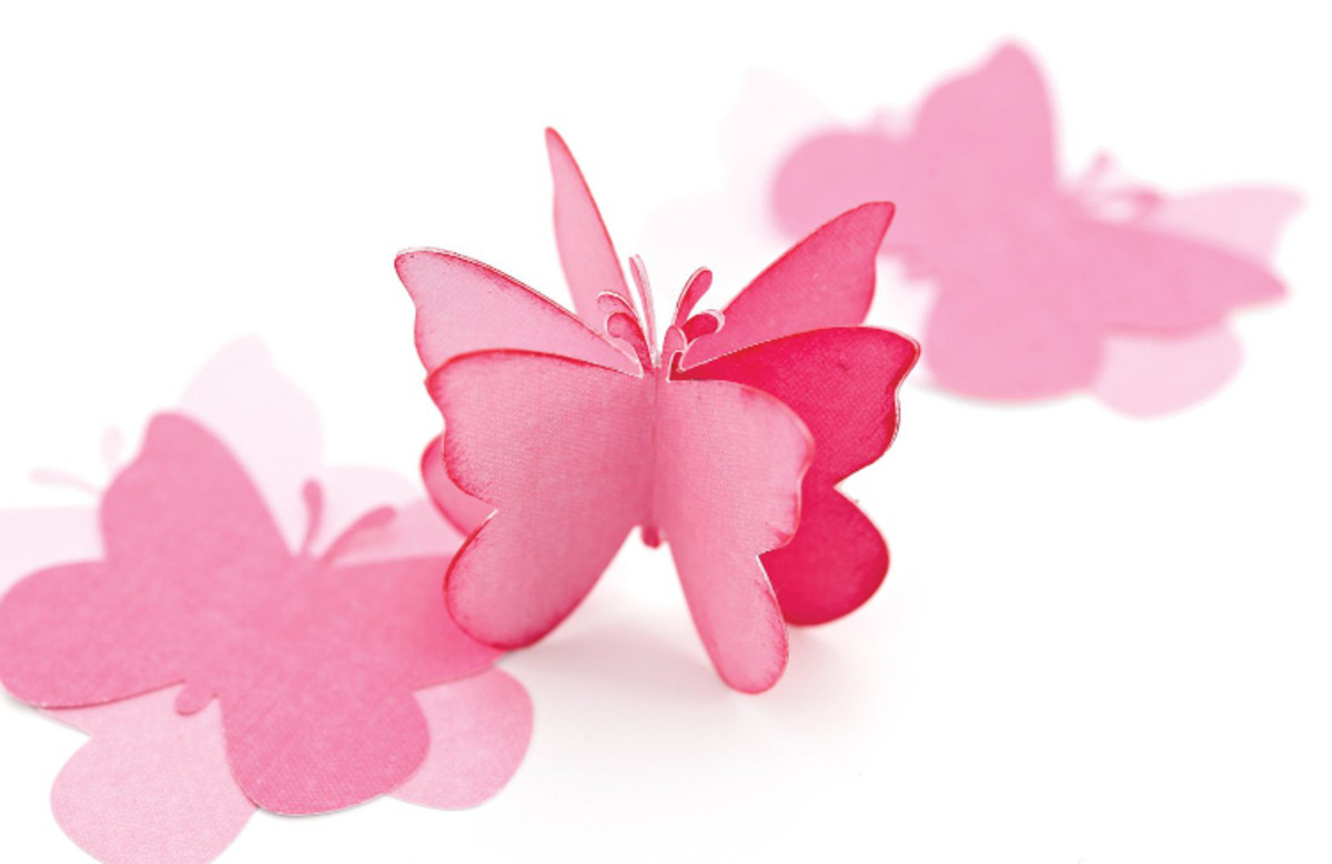 Even simple little punched butterflies can be layered up in an interesting way to make pretty decorations like these.