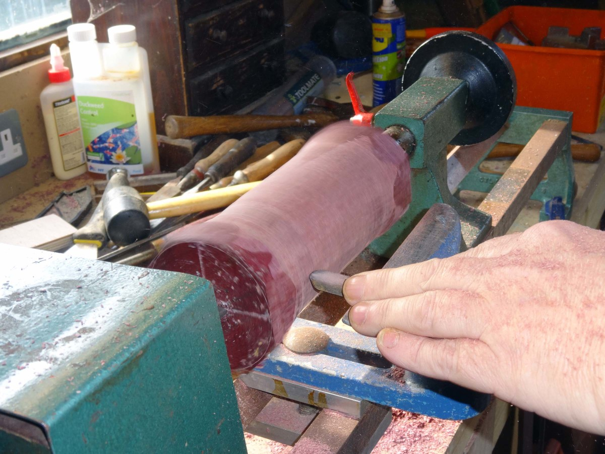 Using the lathe to make the handle from Purpleheart wood with insert for Maine Coon Cat motif coin.