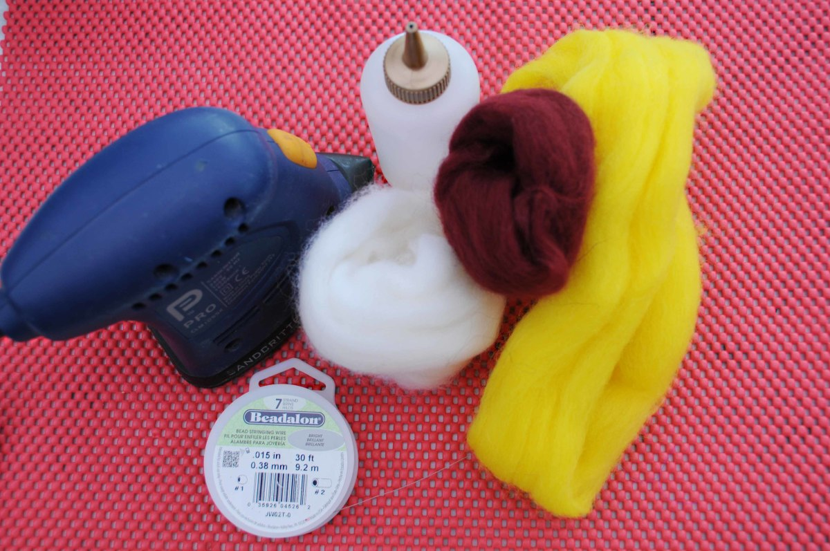 Palm Sander, Squeeze Bottle, Wool Roving and Silver Wire.