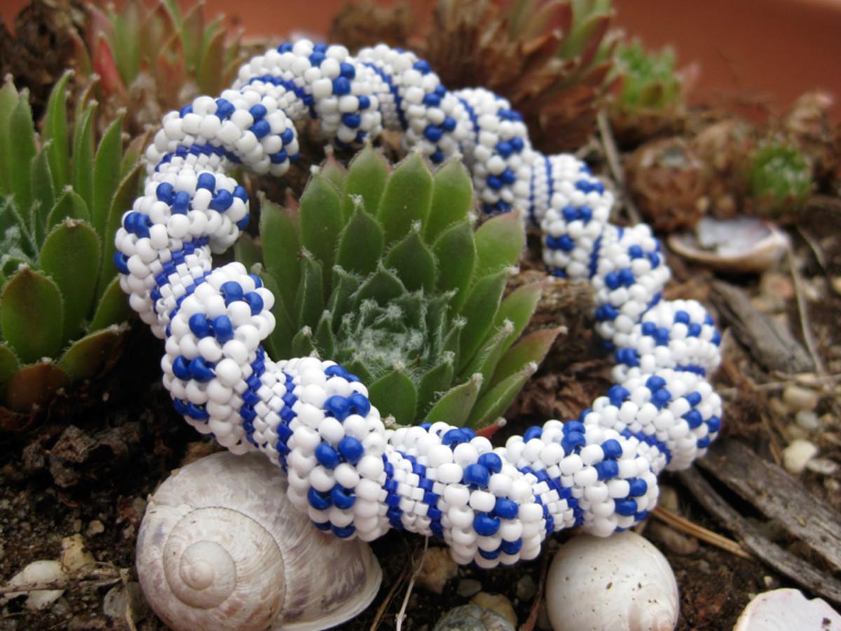 White spotted cellini spiral bracelet.