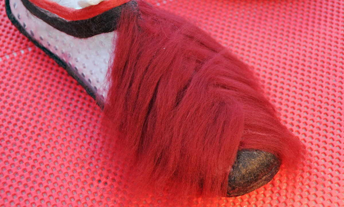 Adding fibers to the shoe, alternating layers to help with the felting process