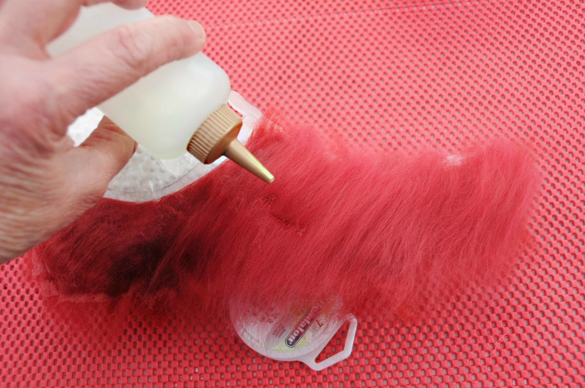 Adding warm soapy water to the fibers