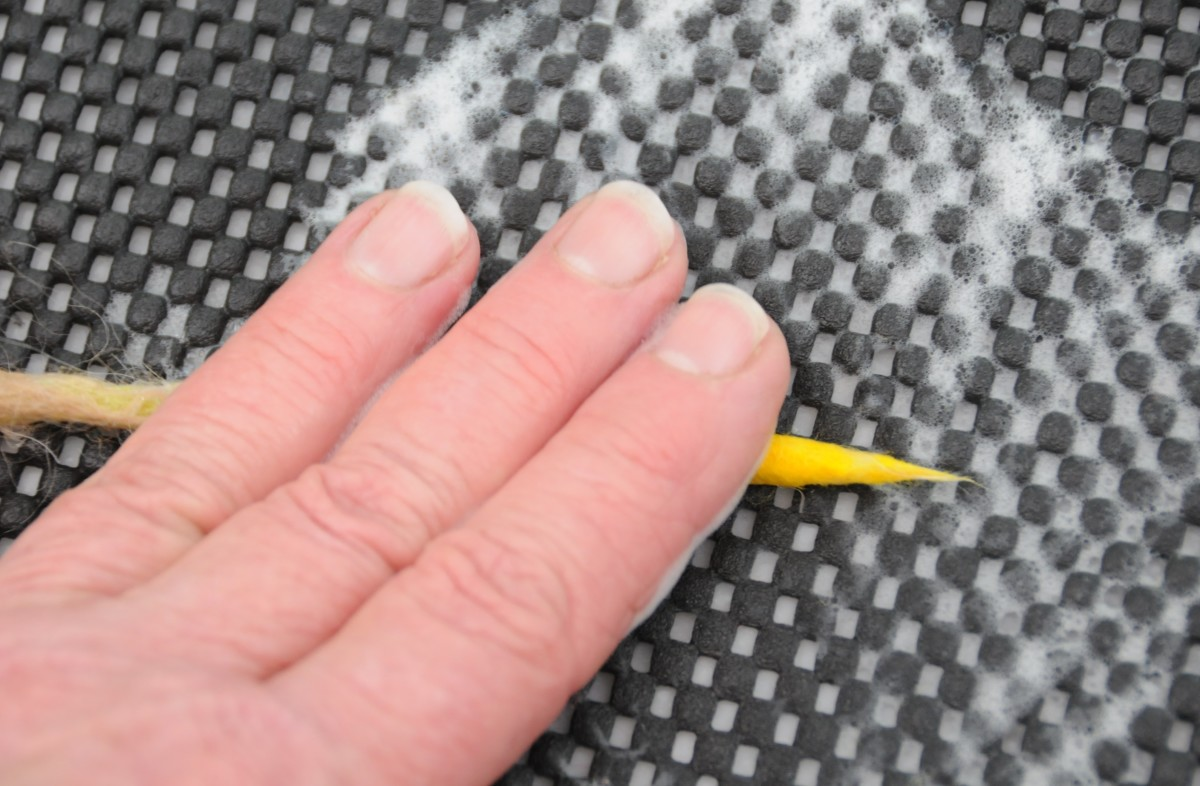Roll well until fully felted.  You may wish to add two layers to the yellow section to make it more defined.