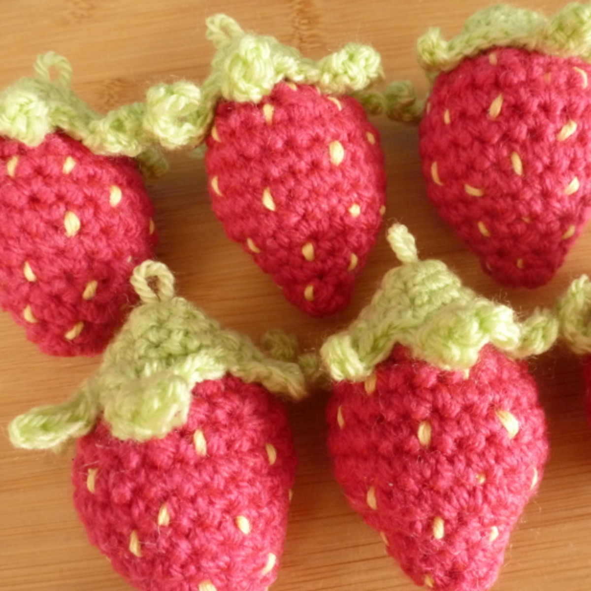 Mini crochet plush strawberries ready to use as decorations.