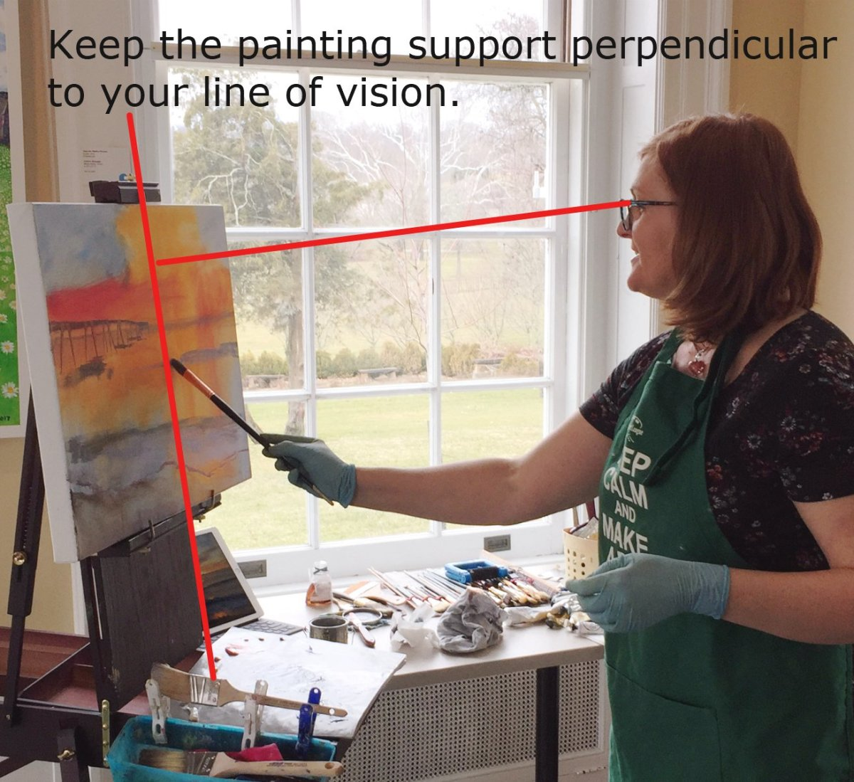 A photo of me painting. Notice how I keep the canvas perpendicular to my line of vision.