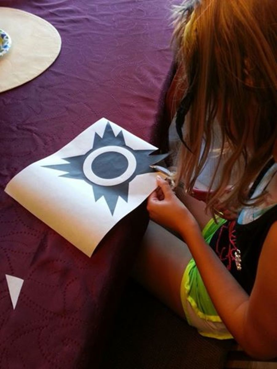 Cut the symbol out of the freezer paper to make the perfect template for your shirt.