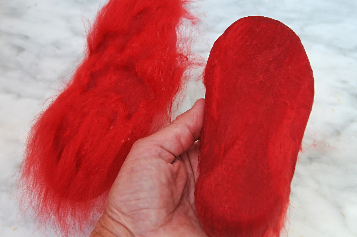 Merino wool roving being placed on beach shoes