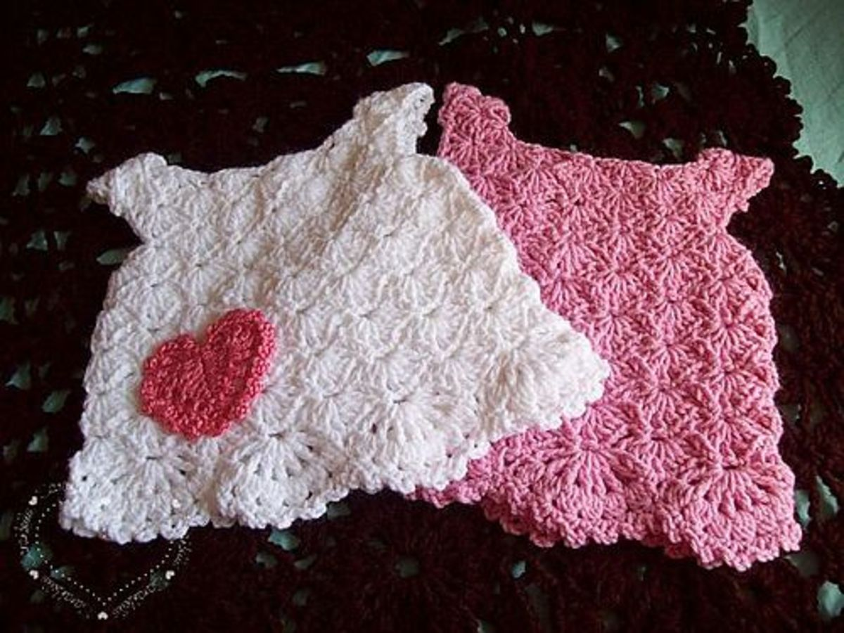 White and pink baby dresses.