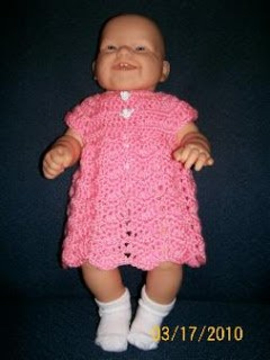 Ripple chevron baby dress on a doll.