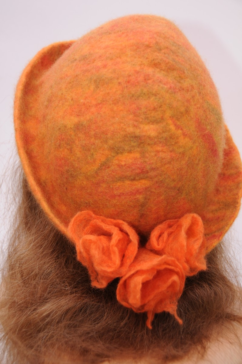 Wet felted hat with felted flowers.