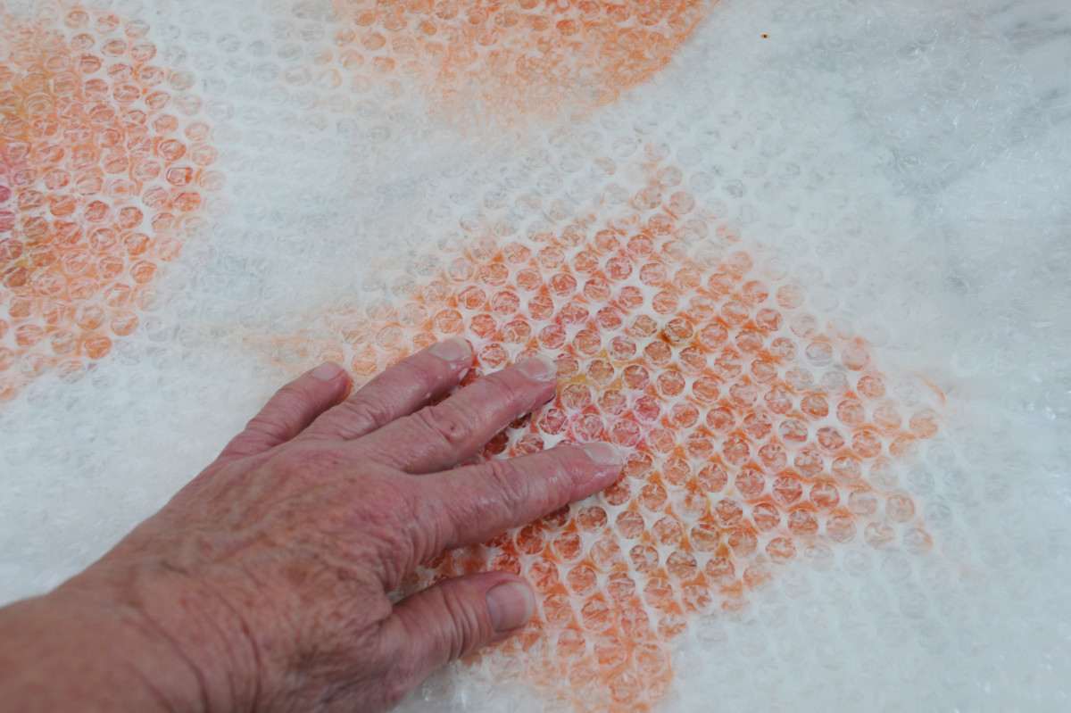 Covering with bubble-wrap.  Rub until the fibers no longer move under your fingers.
