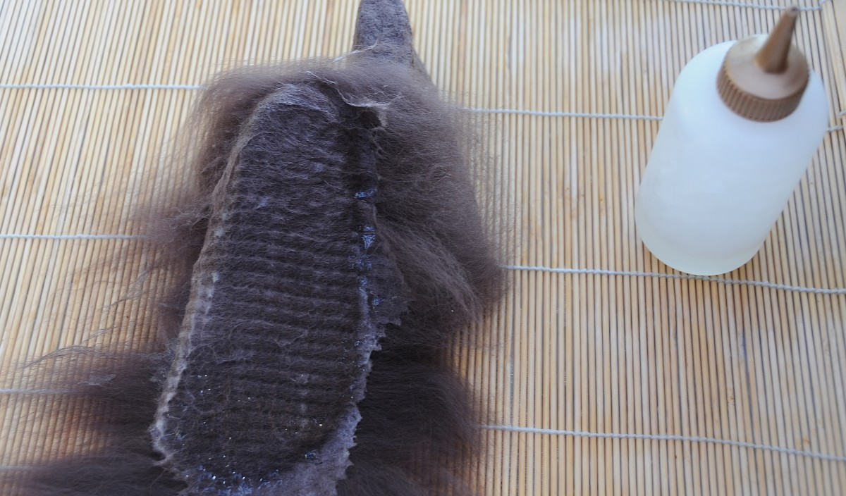 Wet fibers flattened down on the underside of the shoe last