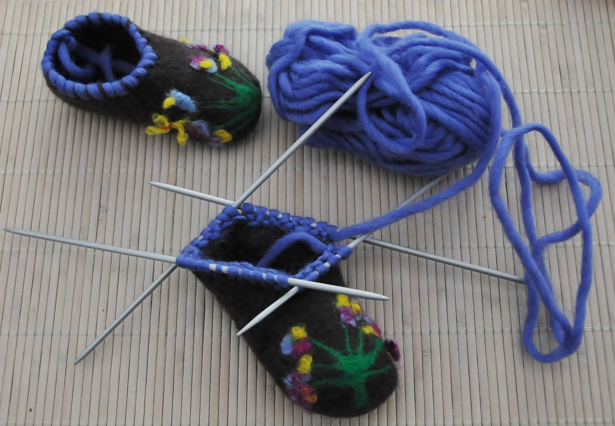 Pick up the stitches around the bootie with four sock knitting needles.