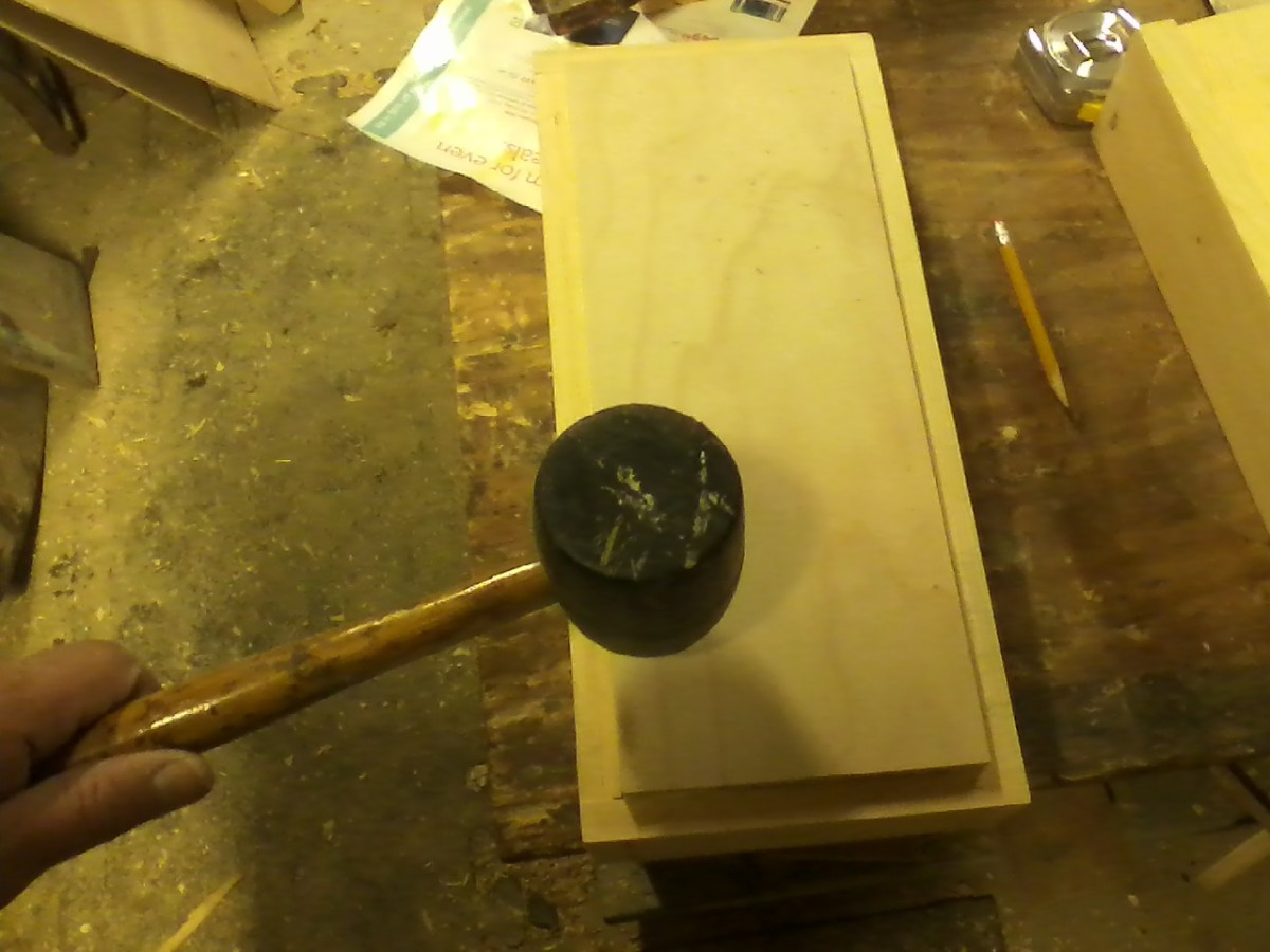 Tap the bottom piece in gently and evenly after putting light glue around its edge.