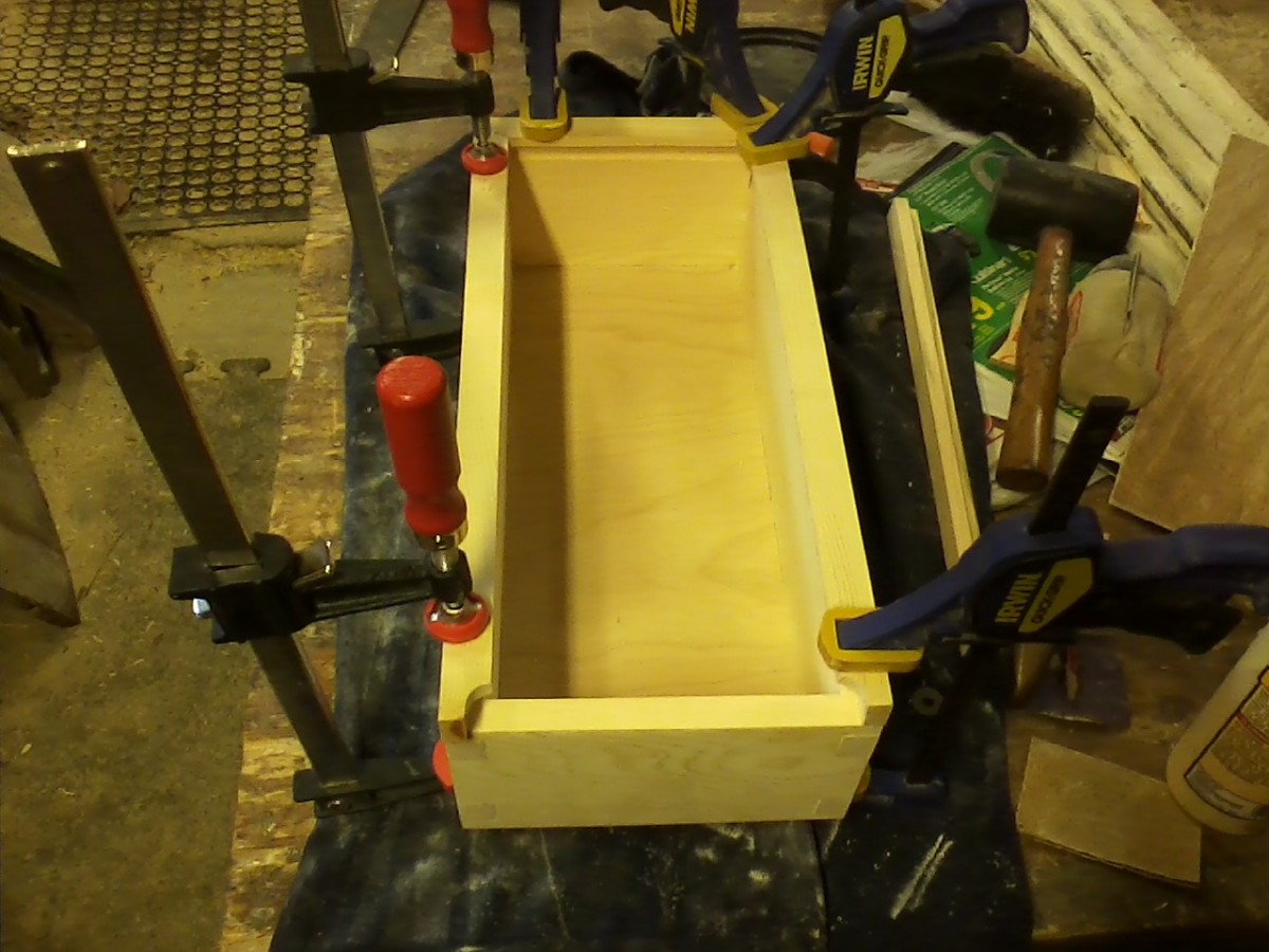 The pieces get a 45 degree miter and then they are glued to the box.