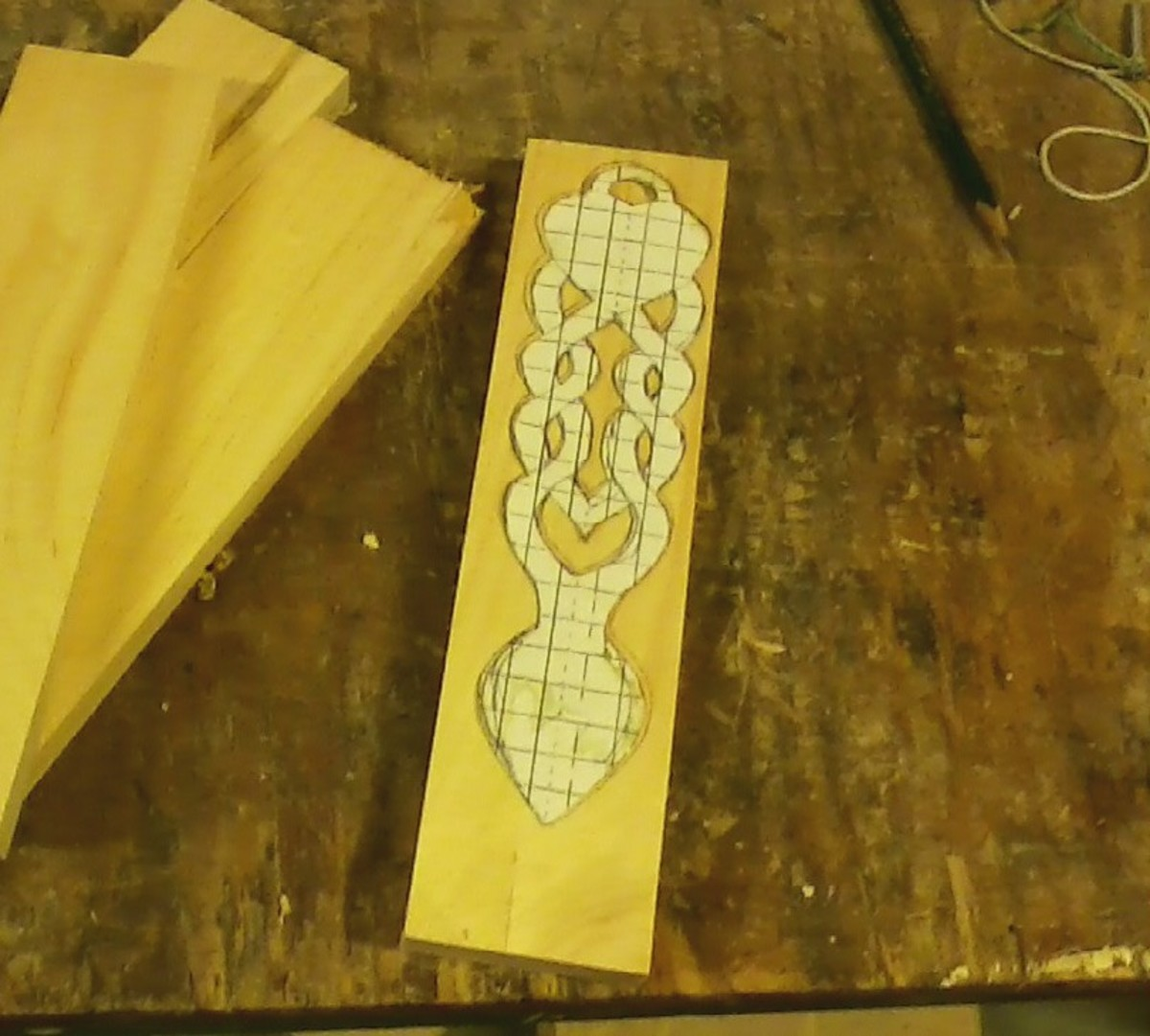 Transferring the pattern to the wood.