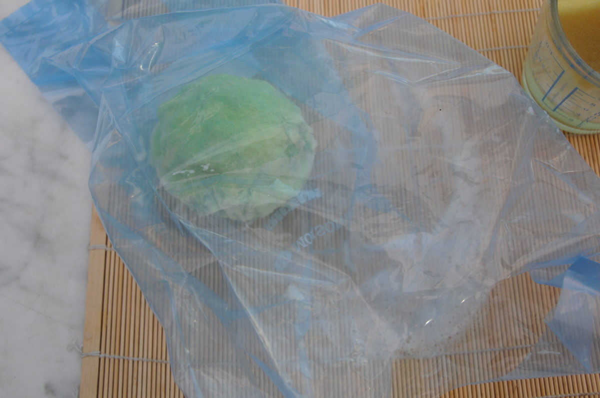 Put a little hot soapy water into a plastic bag and roll gently until smooth. (An alternative to rolling on a sushi mat.  I find the former easier.