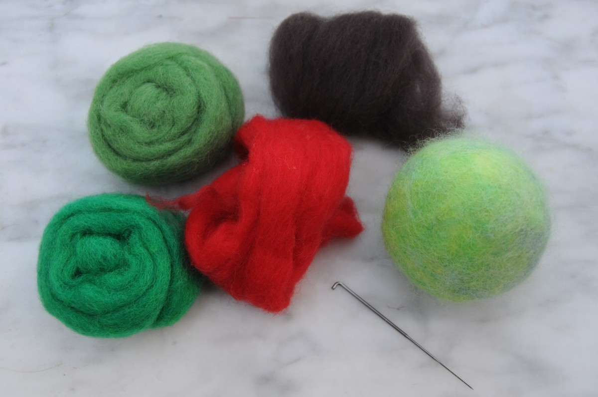 Merino wool roving and needle felting tool.