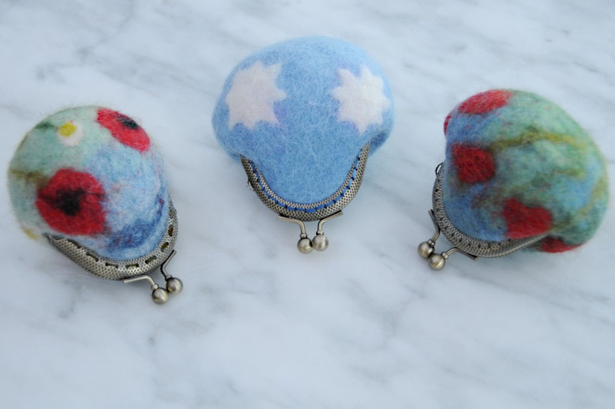 A group of completed, needle/wet felted coin purses.